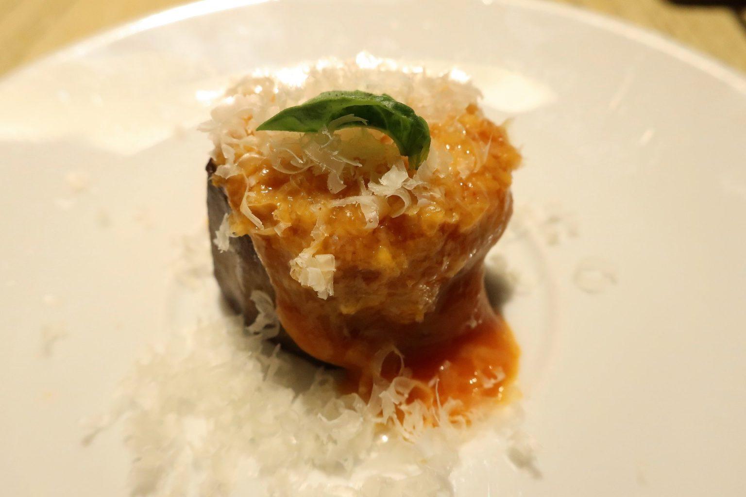 Melanzane alla parmigiana. Grano di pepe.